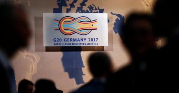 People arrive for the G20 agriculture ministers meeting in Berlin