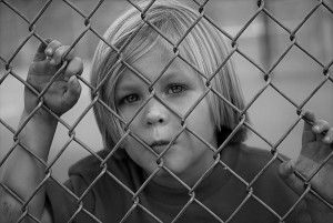 young boy chain fence